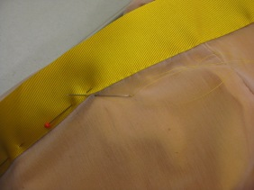 Zipper shield attached by hand