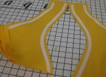 Fusible stay tape applied to seam lines on upper front