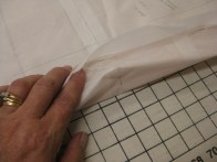 Pin pattern through fabric and tissue